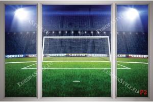 Фототапети прозорец изглед на стадион с нощни светлини и голяма врата