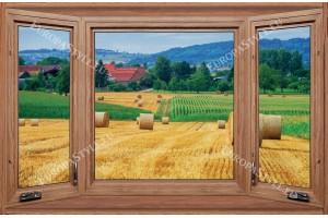 Фототапети дървен прозорец с изглед на поле с бали