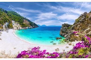 Фототапет морски залив плаж с лилави цветя