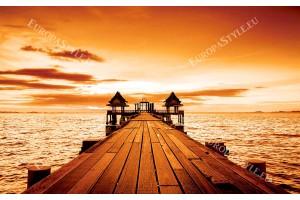 Фототапет мостик с прекрасен залез в син и оранжев цвят