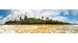 Фототапети макси изглед на остров с фар и палми